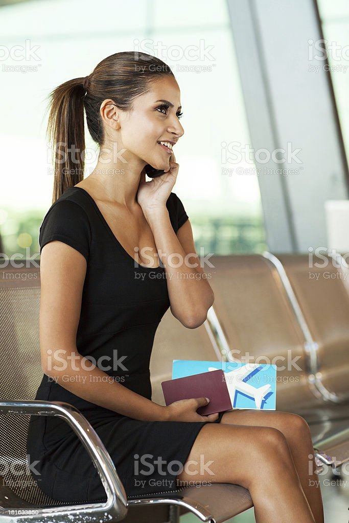 businesswoman talking on cell phone at airport royalty-free stock photo
