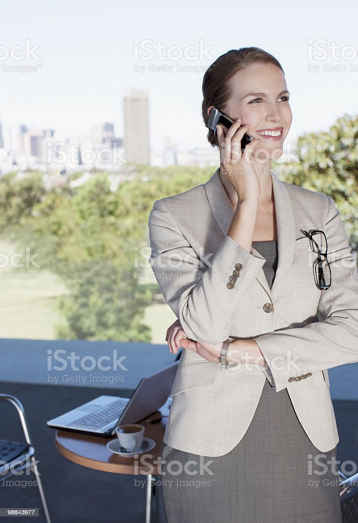 Businesswoman talking on cell phone in cafe royalty-free stock photo