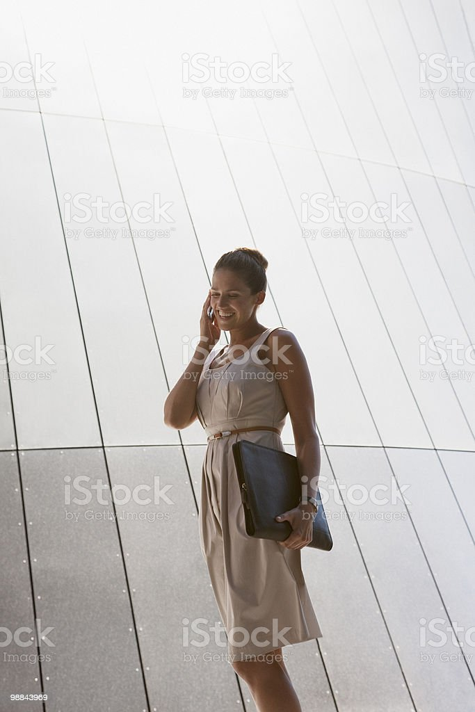 Businesswoman talking on cell phone outdoors 免版稅 stock photo