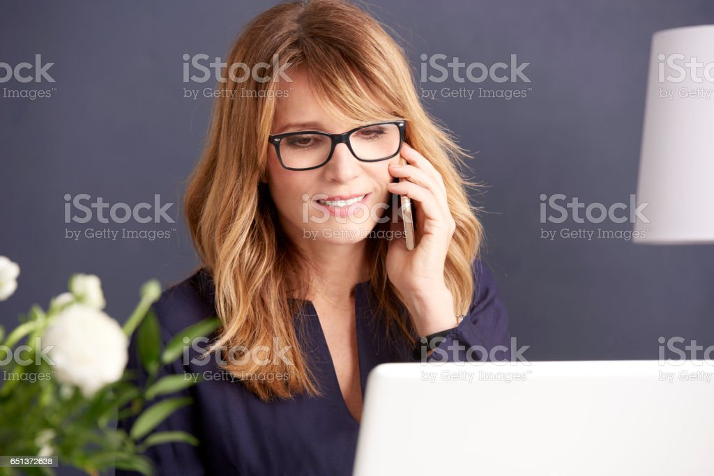 Businesswoman talking on her cellphone stock photo