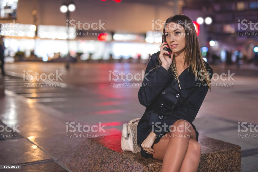 Businesswoman talking on phone in the city royalty-free stock photo