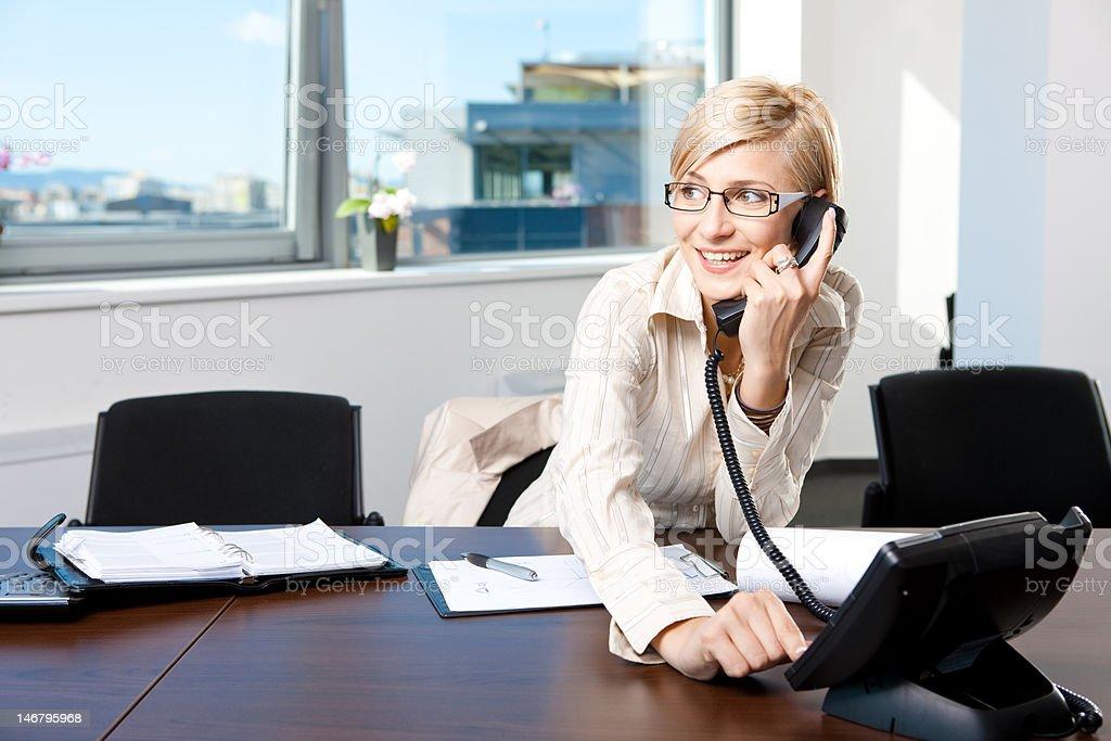 Businesswoman talking on phone royalty-free stock photo
