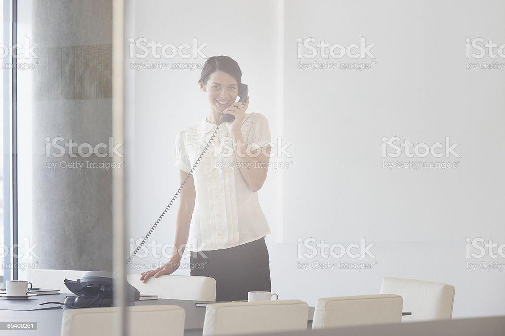 Businesswoman talking on telephone royalty-free stock photo