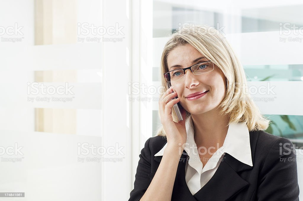 Businesswoman talking over the phone royalty-free stock photo
