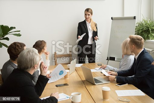 1085713886 istock photo Businesswoman talking to business team answering questions at group meeting 924519776