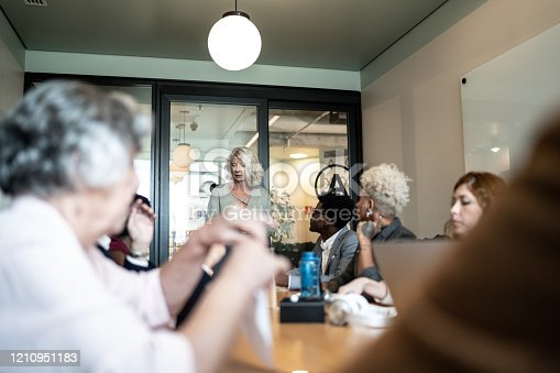 892254154 istock photo Businesswoman talking to her colleagues on presentation in the office 1210951183