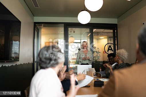 892254154 istock photo Businesswoman talking to her colleagues on presentation in the office 1211013249