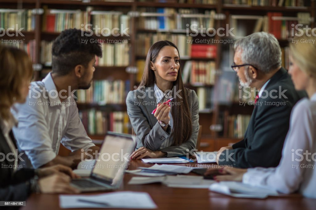 Businesswoman talking to her team about new business ideas on a meeting. stock photo