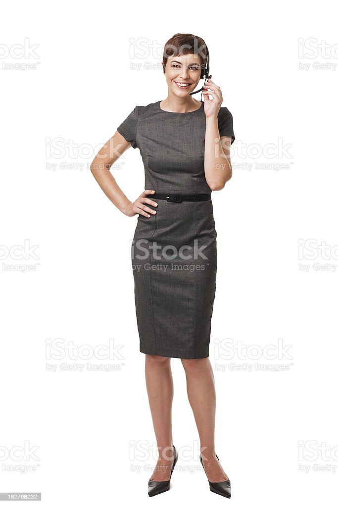 Businesswoman Talking With Headseat. Isolated on White royalty-free stock photo