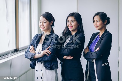 istock Businesswoman team cross one's arm and smiling to success job.Successful Teamwork Partnership at office 1038332760
