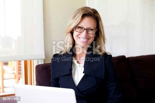 istock Businesswoman teleworking at home. On a Laptop. Smiling 637917882