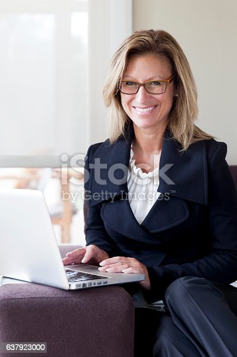 istock Businesswoman teleworking at home. On a Laptop. Smiling 637923000