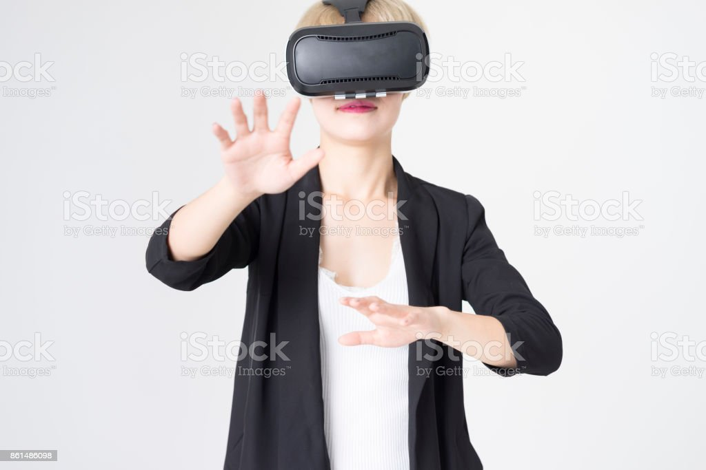 businesswoman testing virtual reality simulator technology against white background stock photo