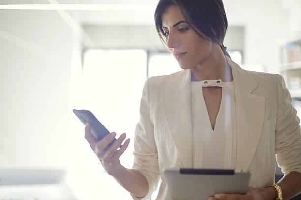 Businesswoman text messaging stock photo