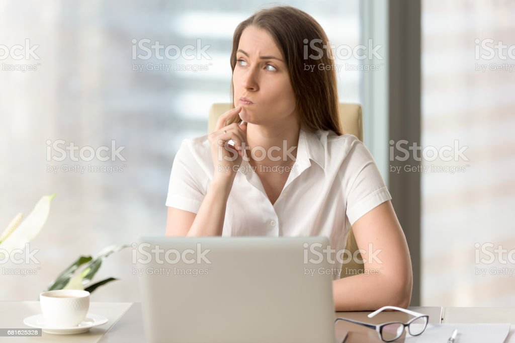 Businesswoman thinking about difficult question stock photo