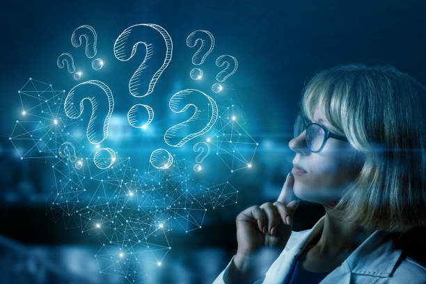 Businesswoman thinking over questions arising . stock photo