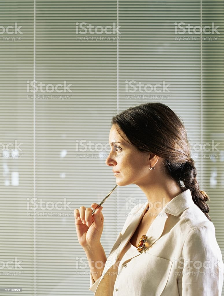 Businesswoman thinking stock photo