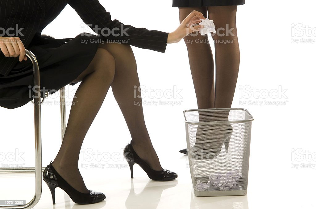 Businesswoman throwing a garbage royalty-free stock photo