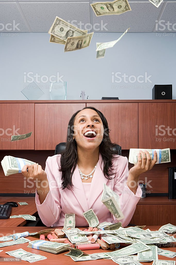 Businesswoman throwing money stock photo