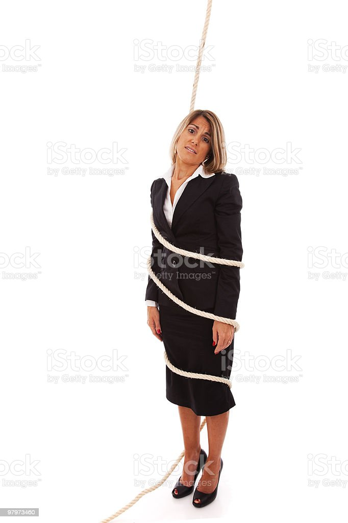 Businesswoman tied with a rope royalty-free stock photo