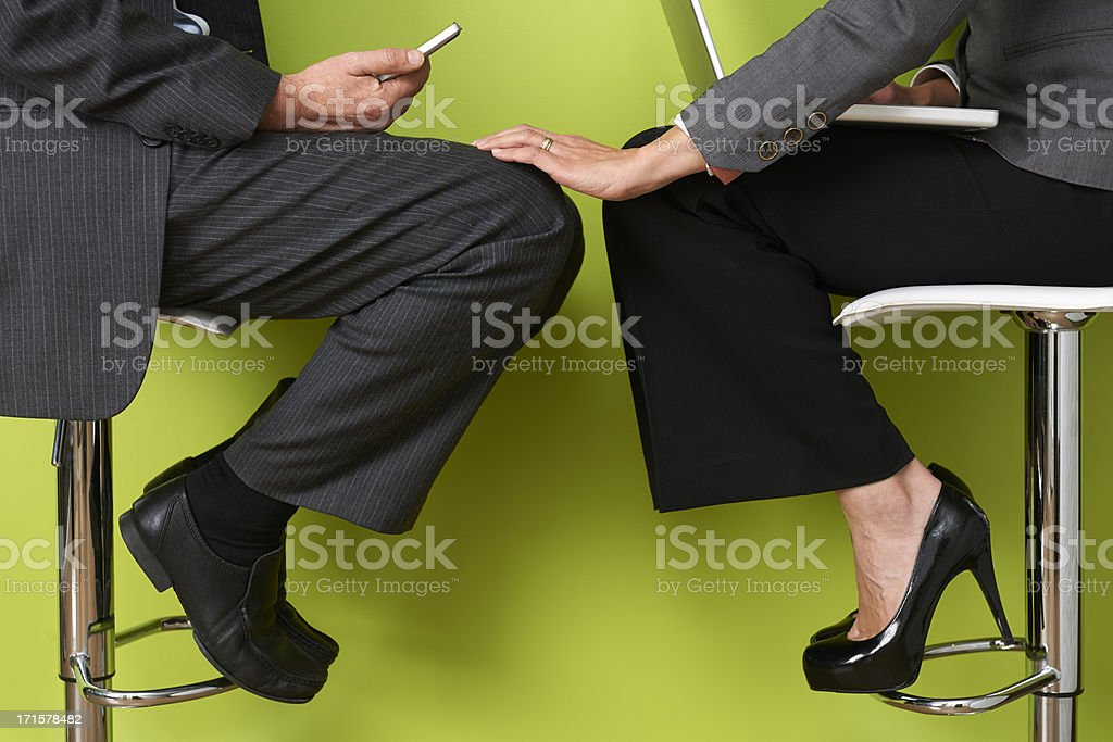Businesswoman Touching Colleague's Leg stock photo