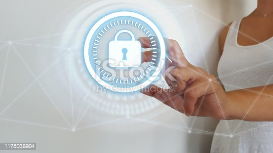 istock Businesswoman touching digital padlock security interface to protect datas 1175036904