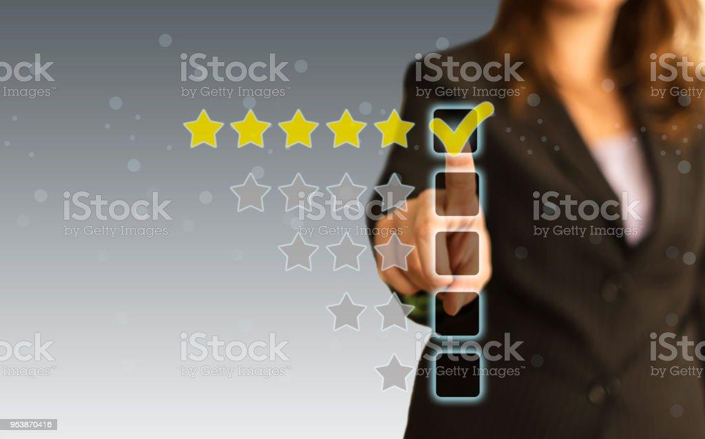 Businesswoman touching five stars stock photo