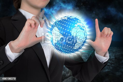 Digital composite of businesswoman touching globe with binary code