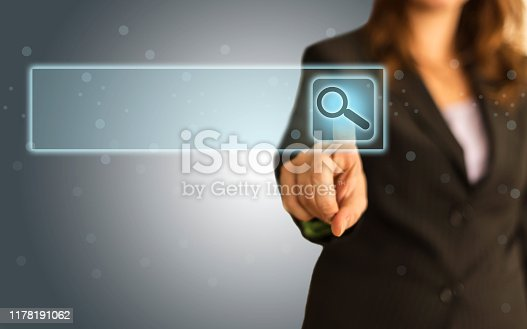 492960182 istock photo Businesswoman Touching Magnifier Icon In Search Box 1178191062