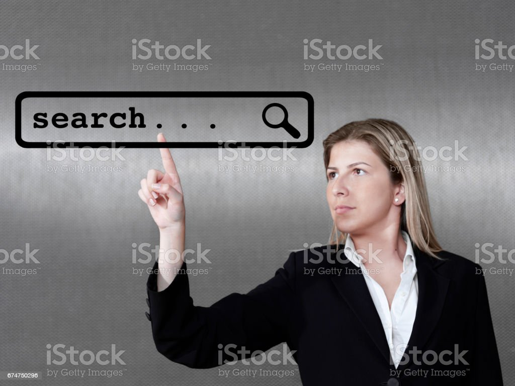 businesswoman touching on a virtual screen stock photo