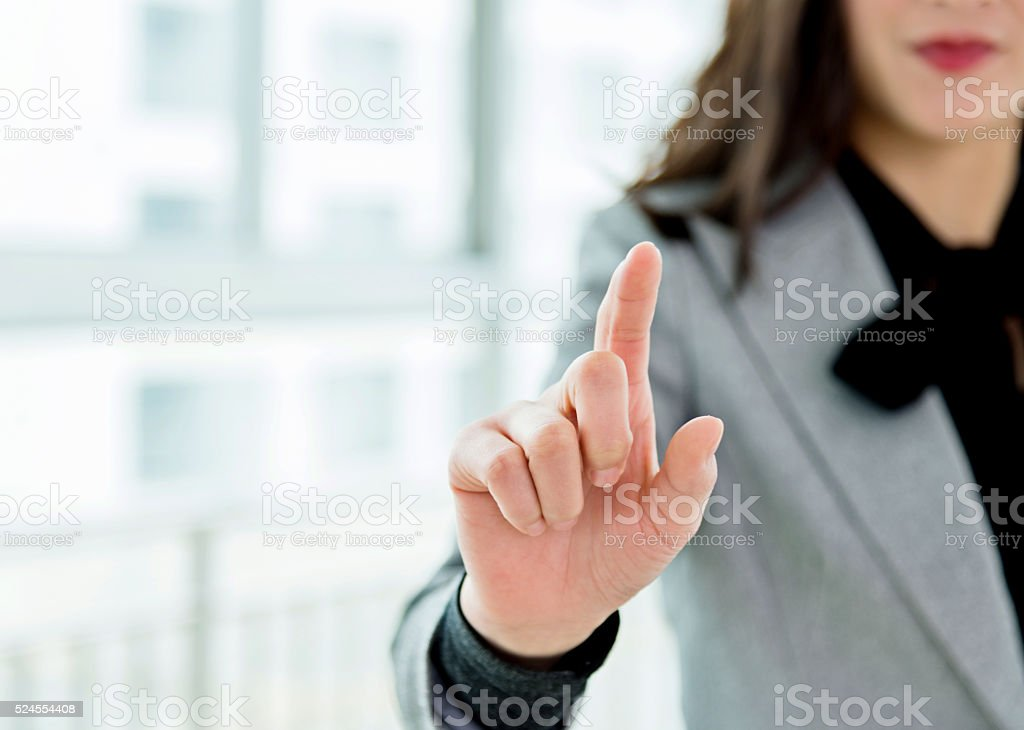 Businesswoman touching something on screen stock photo
