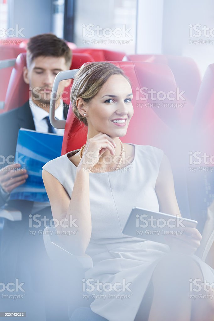 Businesswoman traveling by bus stock photo