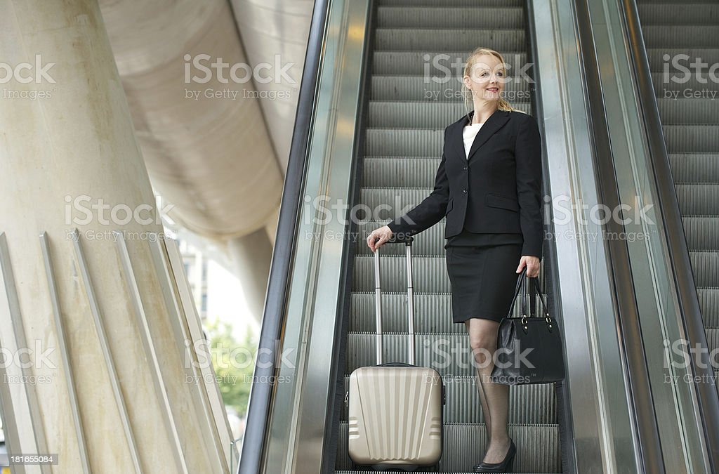 Businesswoman traveling with bags royalty-free stock photo