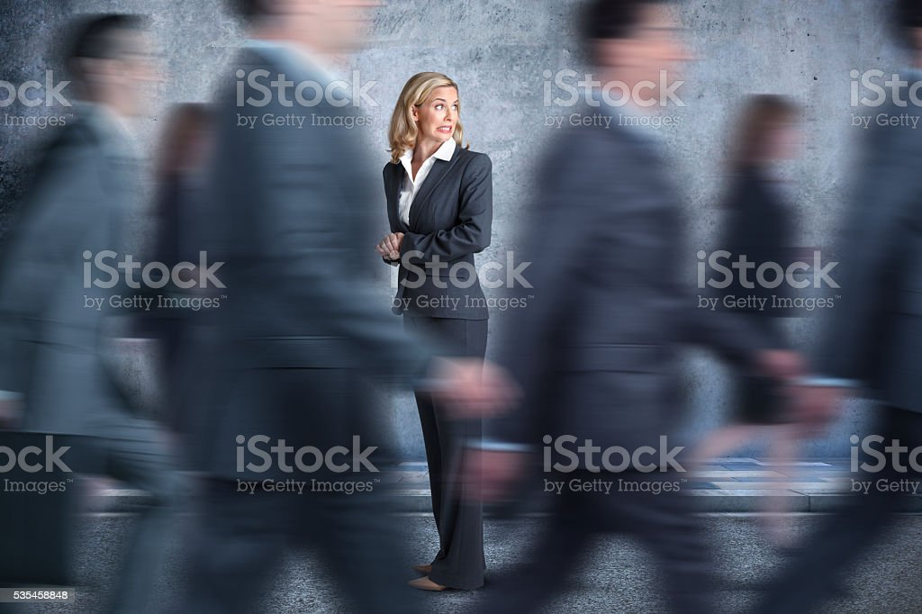 Businesswoman Turns Head To Look In Direction Pedestrians Are Walking stock photo
