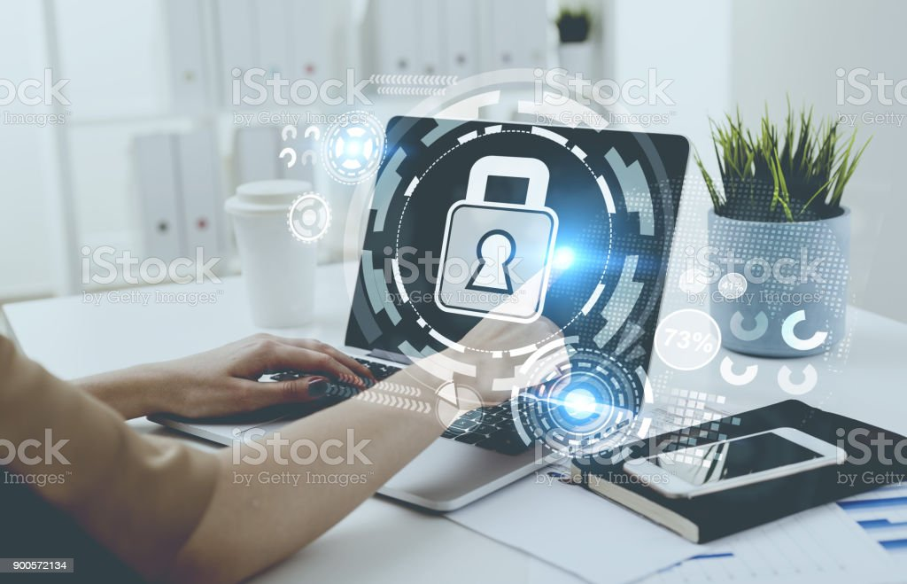 Businesswoman typing, laptop, digital security stock photo