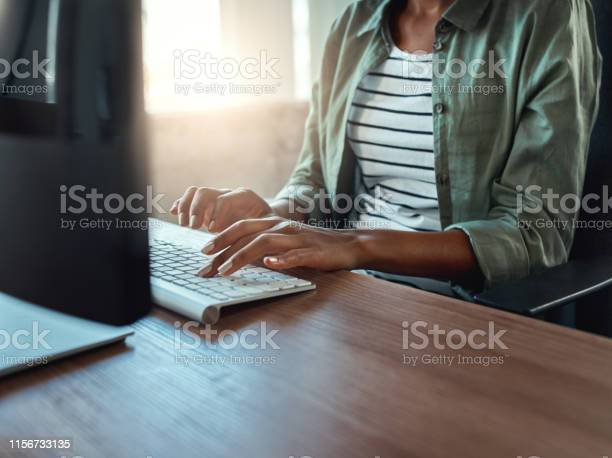 Businesswoman typing on keyboard indoors in a modern building picture id1156733135?b=1&k=6&m=1156733135&s=612x612&h=lkn03txeroqotq4a74eexvkjca abmvx3zt0ahdttcw=