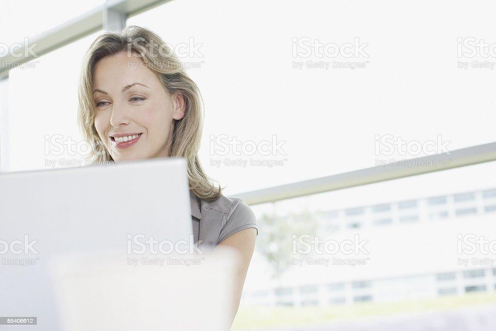 Businesswoman typing on laptop royalty-free stock photo