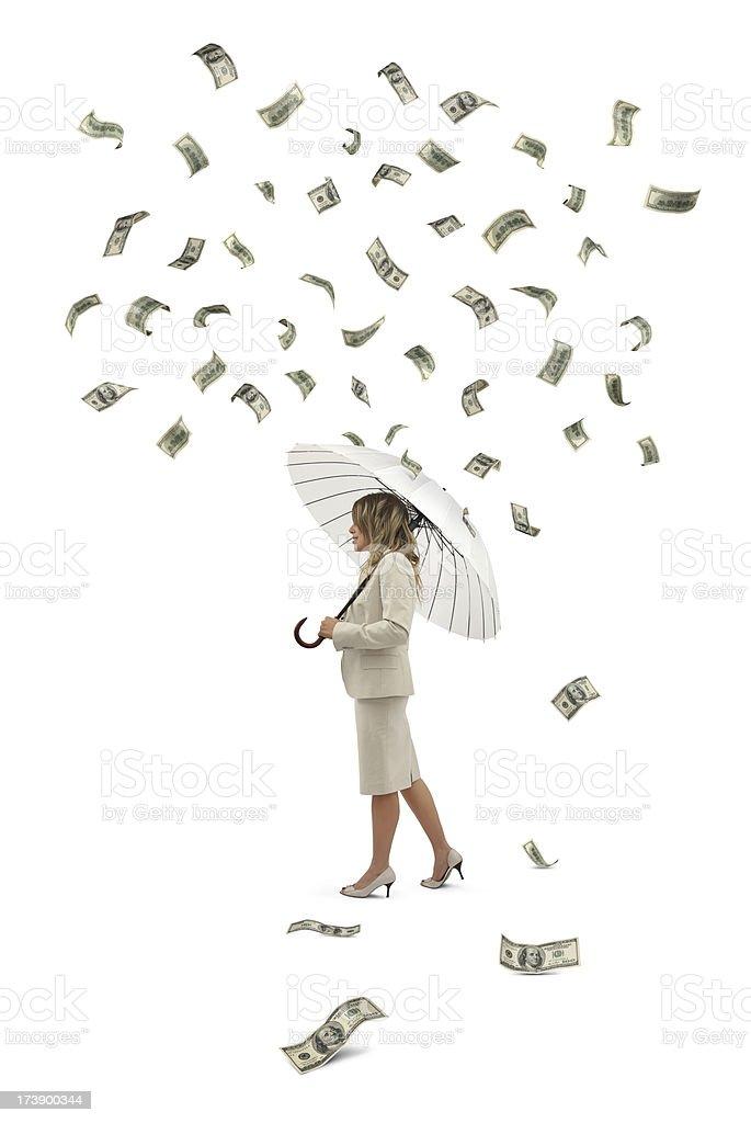 Businesswoman Under The Money Rain stock photo