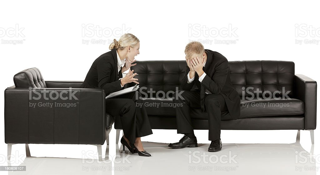 Businesswoman upset with co-worker royalty-free stock photo