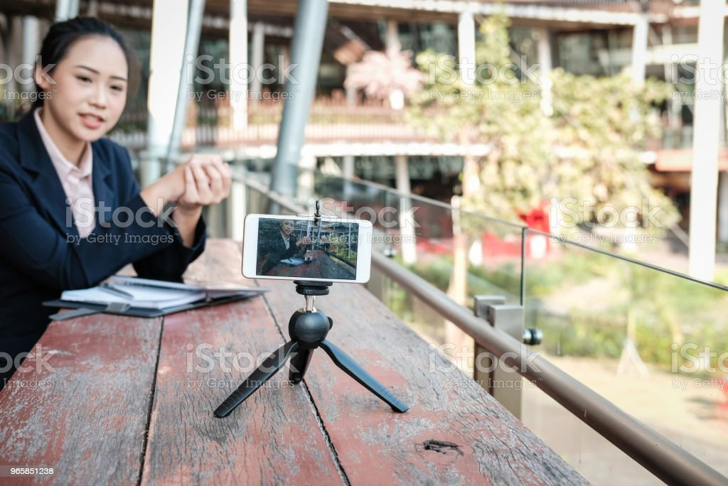 businesswoman use smartphone for online live streaming. woman recording video blog. vlogger presenting business vlog. - Royalty-free Adult Stock Photo