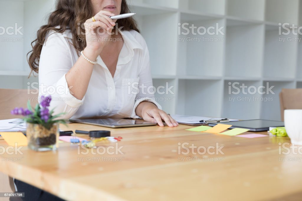 Businesswoman use tablet at workplace. Woman working in home office. royalty-free stock photo