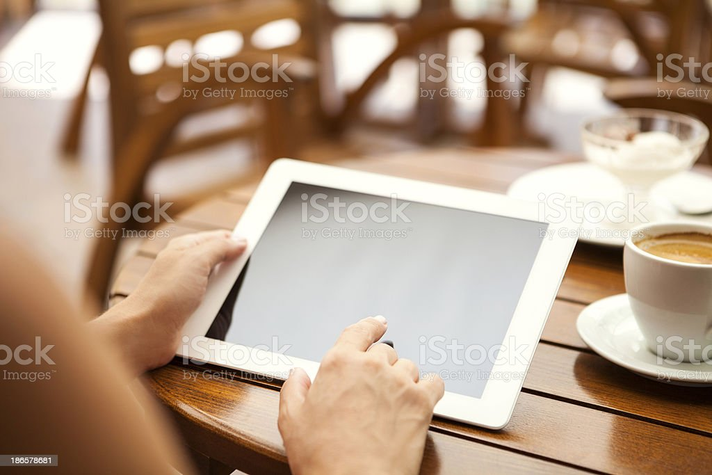 Businesswoman uses digital tablet stock photo