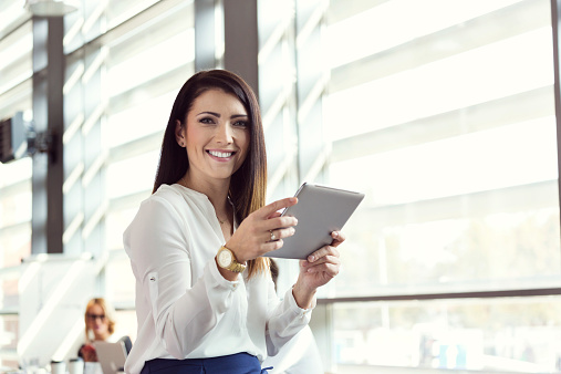 Businesswoman Using A Digital Tablet In An Office Stock Photo - Download Image Now