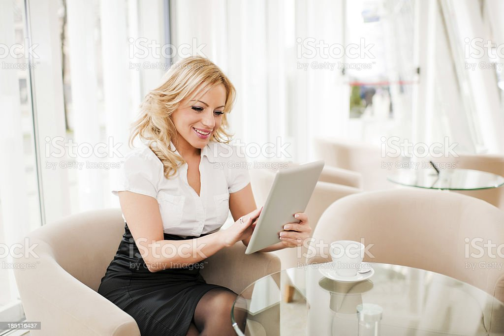 Businesswoman using a digital tablet royalty-free stock photo
