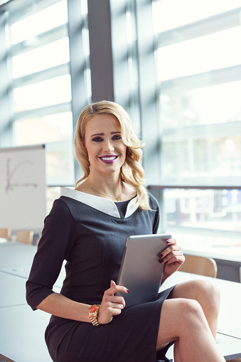 Businesswoman Using A Digital Tablet Stock Photo - Download Image Now