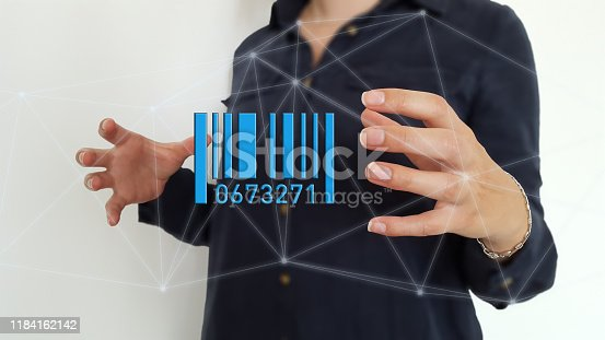 92884259 istock photo Businesswoman using barcode on digital network connections 1184162142