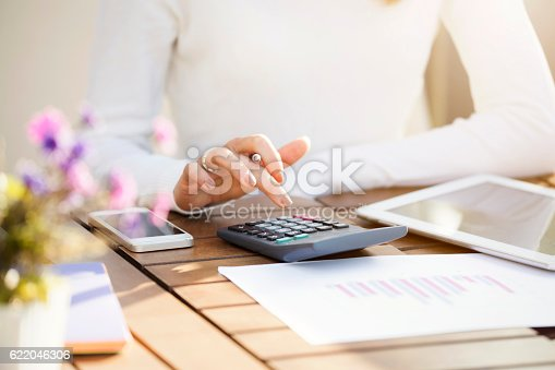 istock Businesswoman using calculator 622046306