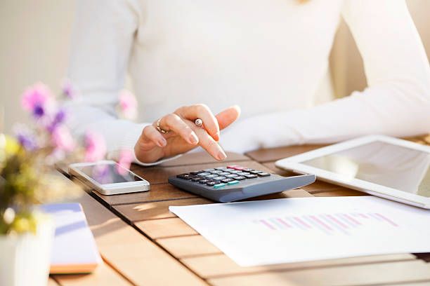 Businesswoman using calculator stock photo