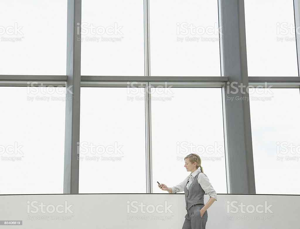 Businesswoman using cell phone royalty-free stock photo