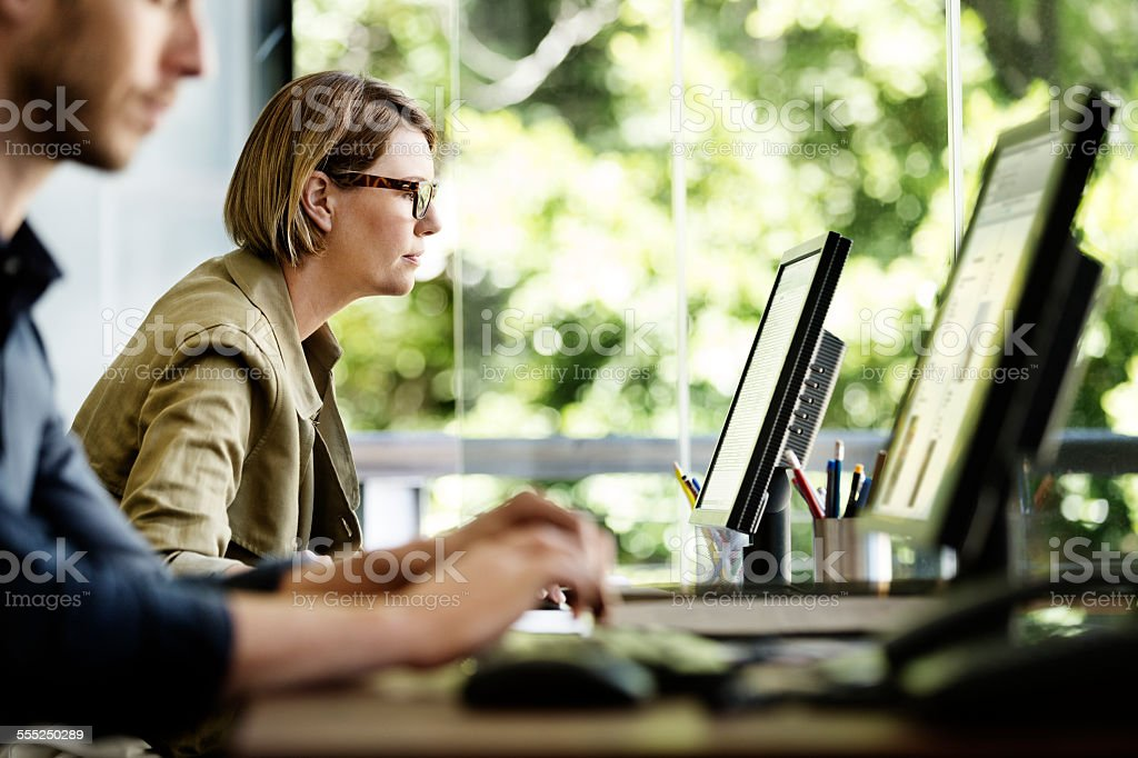 Businesswoman using computer in office stock photo